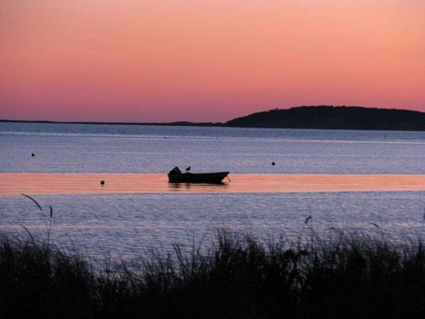 Boat seen at sunset at Mayo Beach in Wellfleet, MA