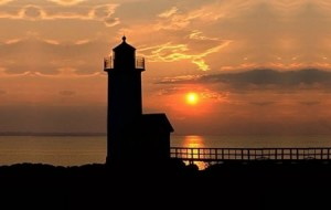 Beautiful sunset over the lighthouse and ocean